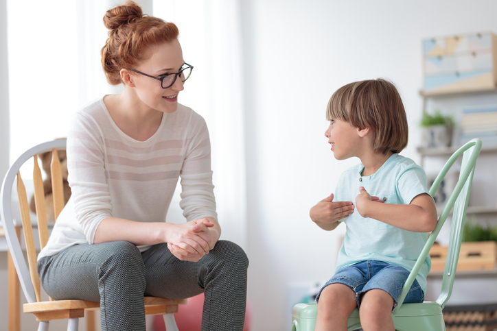 therapist works with young child during a therapy session